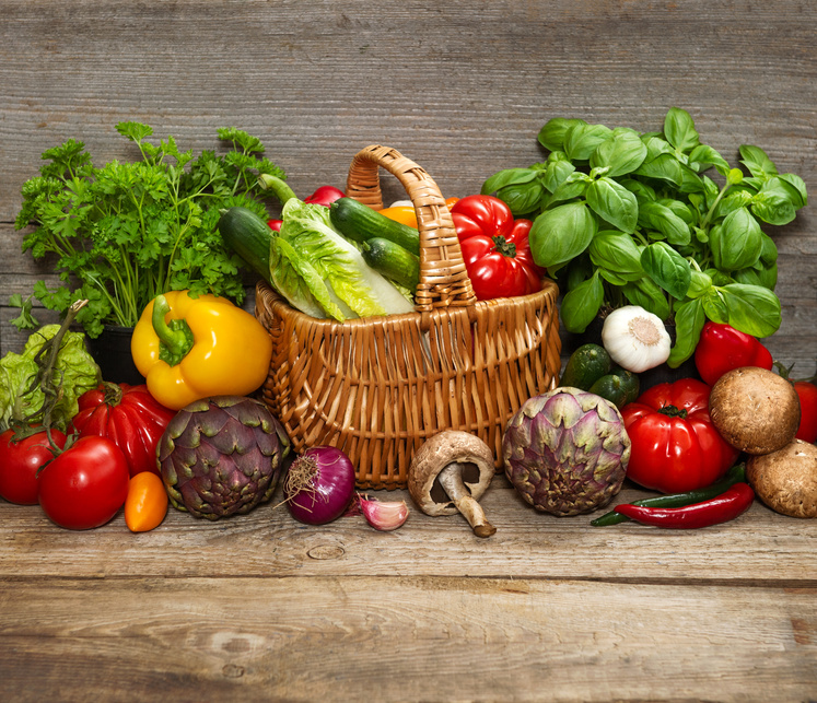 vegetables and herbs on wooden background